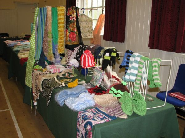 A colourful range of  knitted items